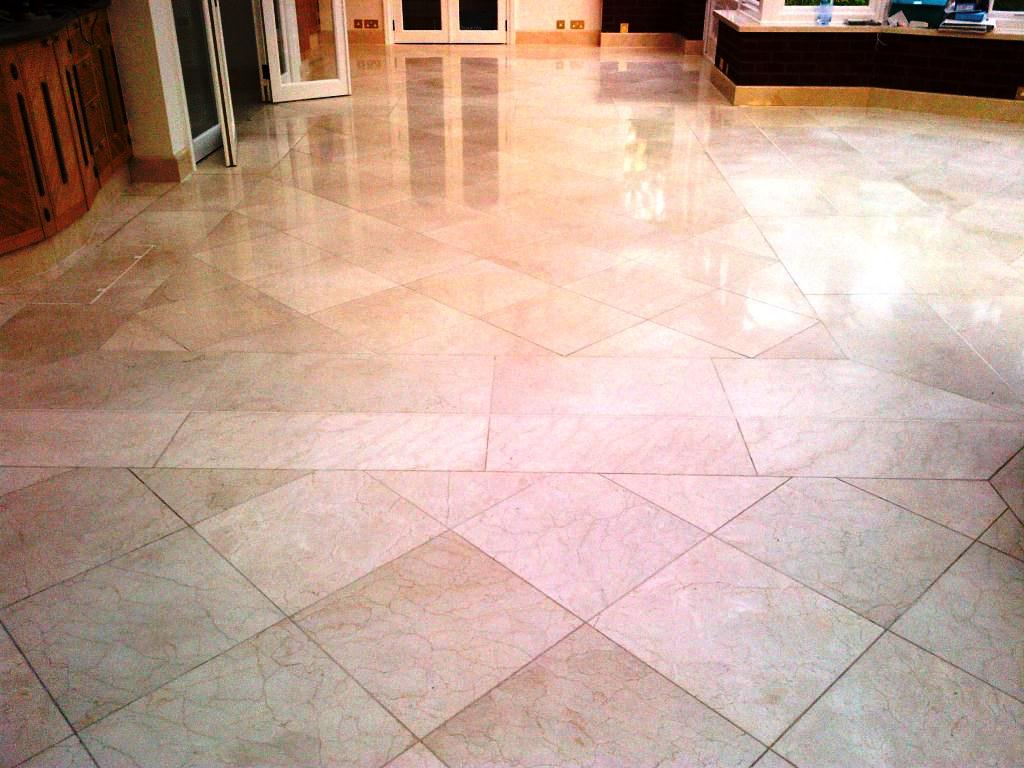 Polishing marble floor tiles