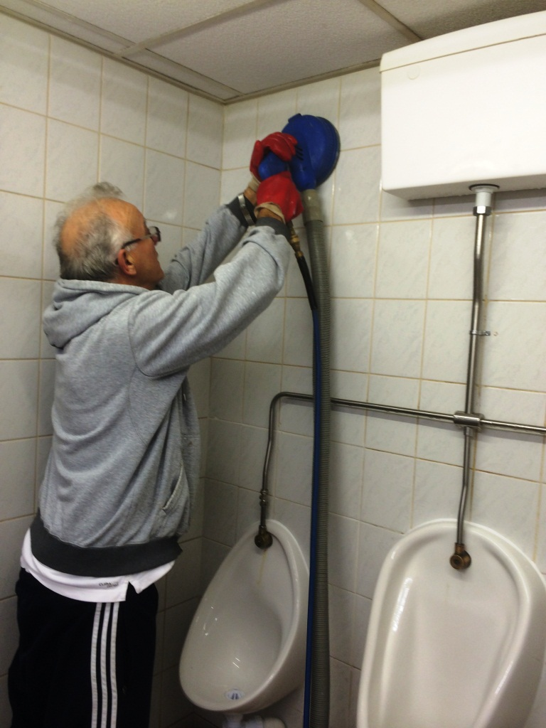 Night Club Urinal Wall Tile Cleaning